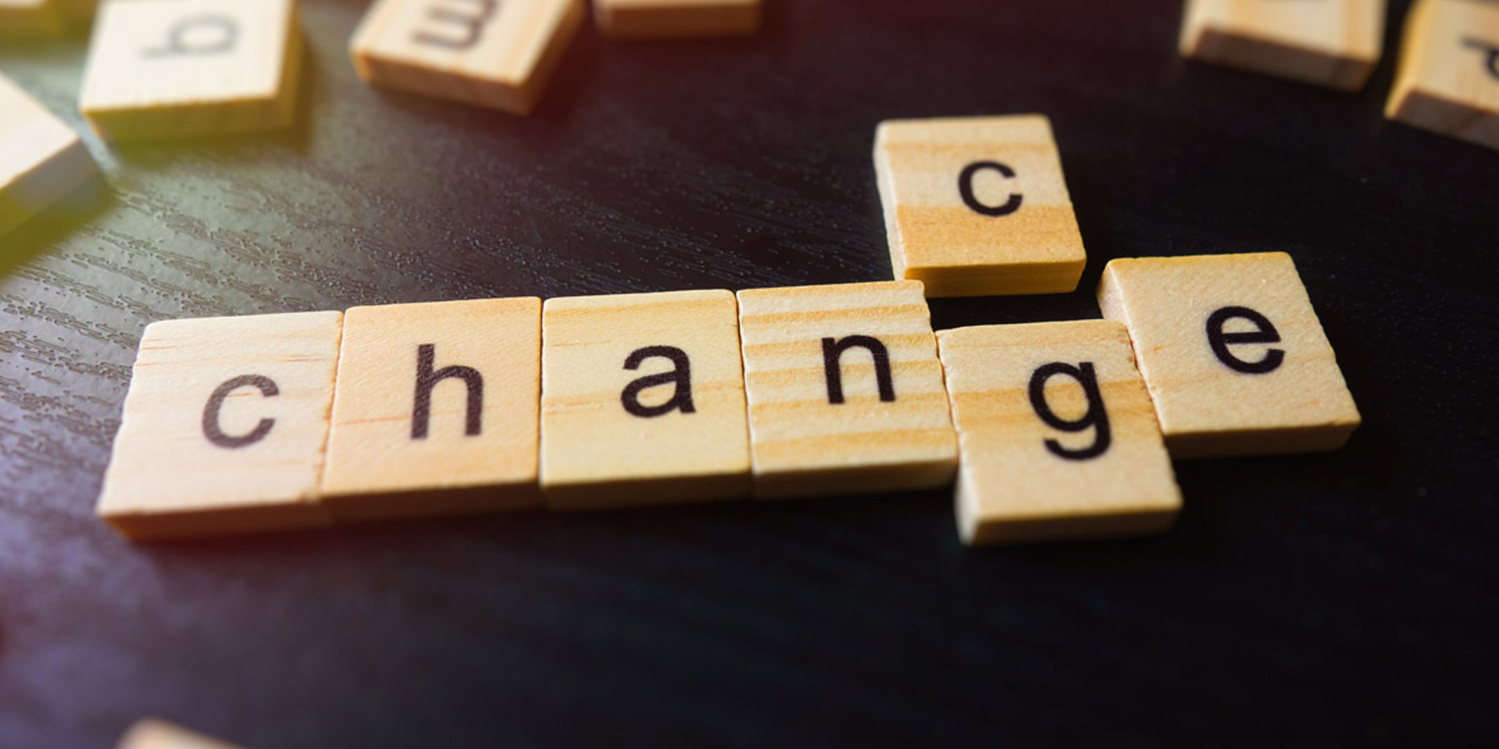 Wooden blocks spelling out change