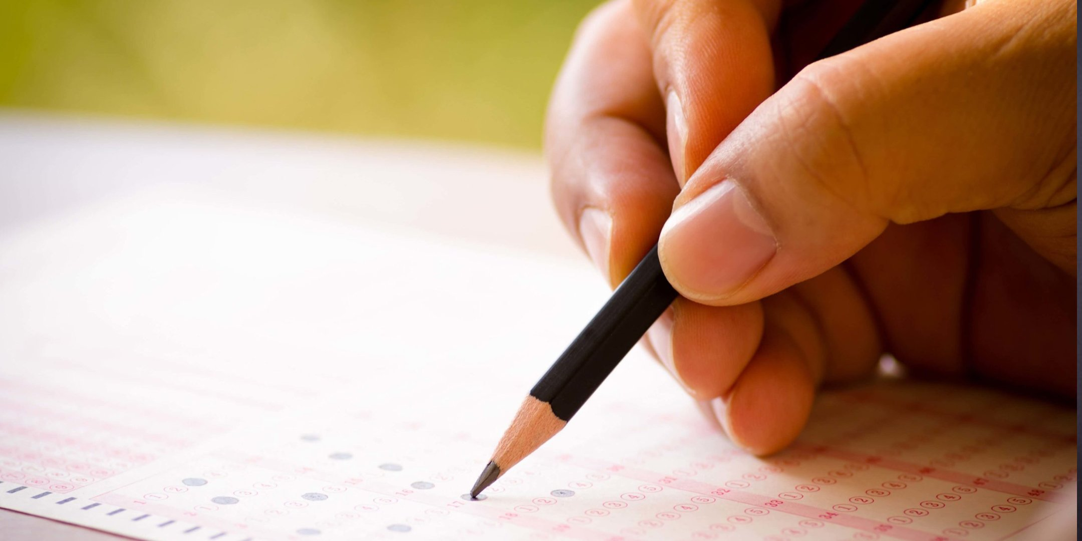 A person taking the multiple-choice APM PFQ Exam.
