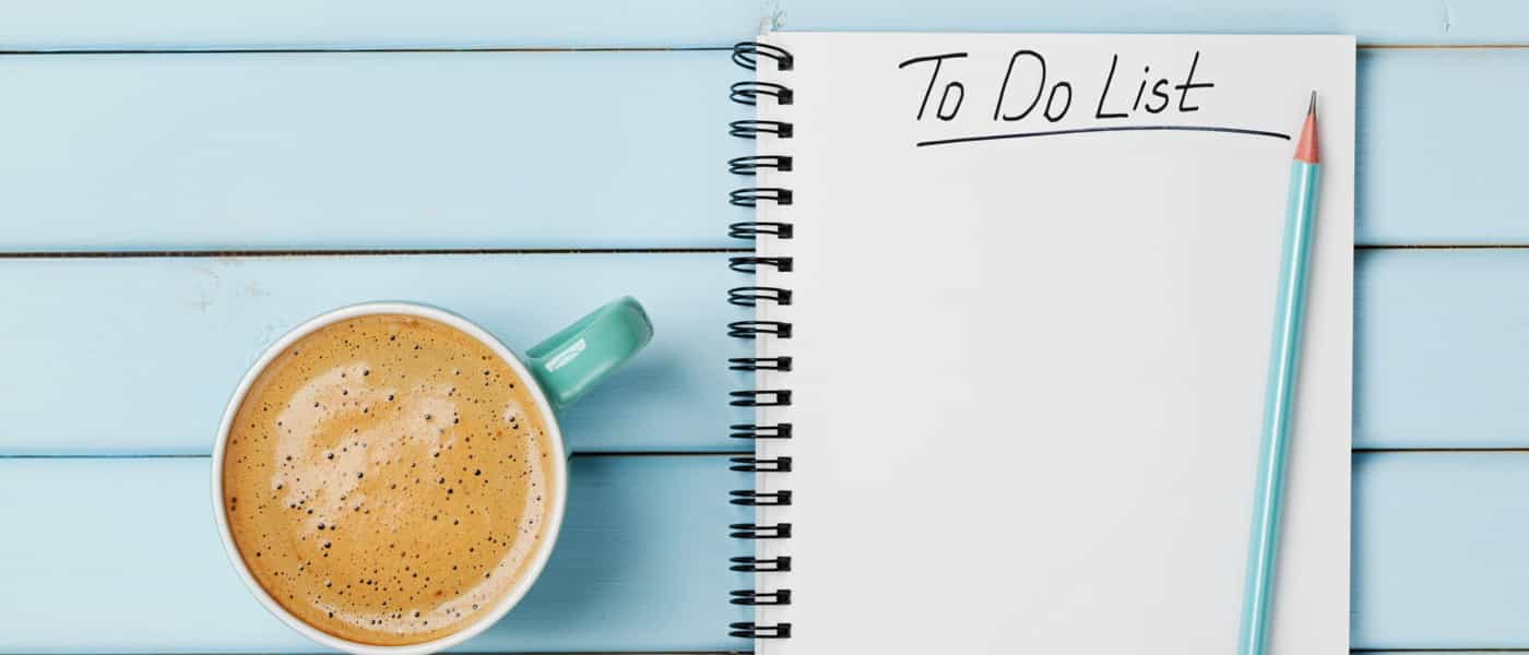 To Do List and Coffee on Blue Wooden Background
