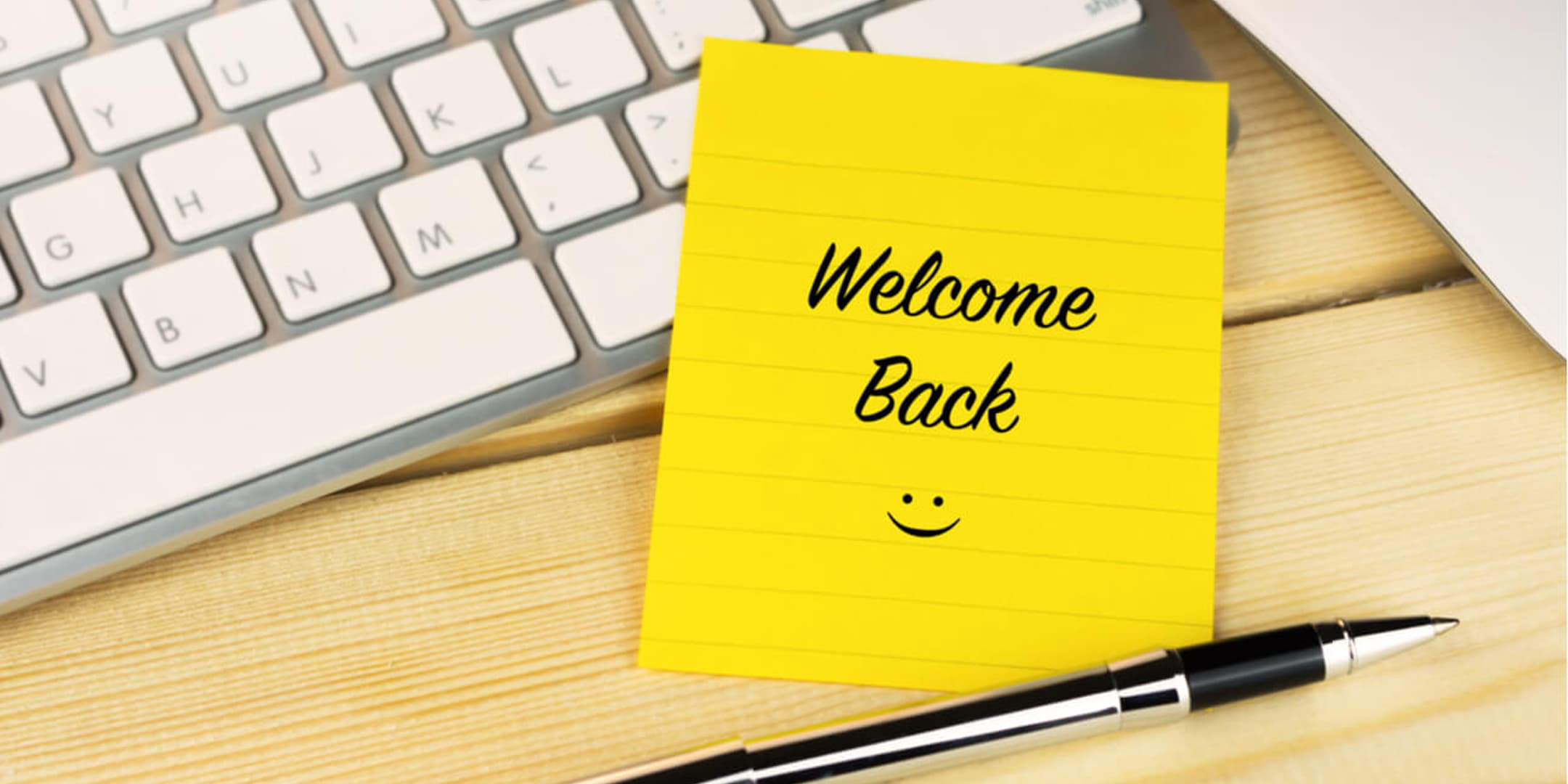 Welcome Back Sticky Note on Keyboard