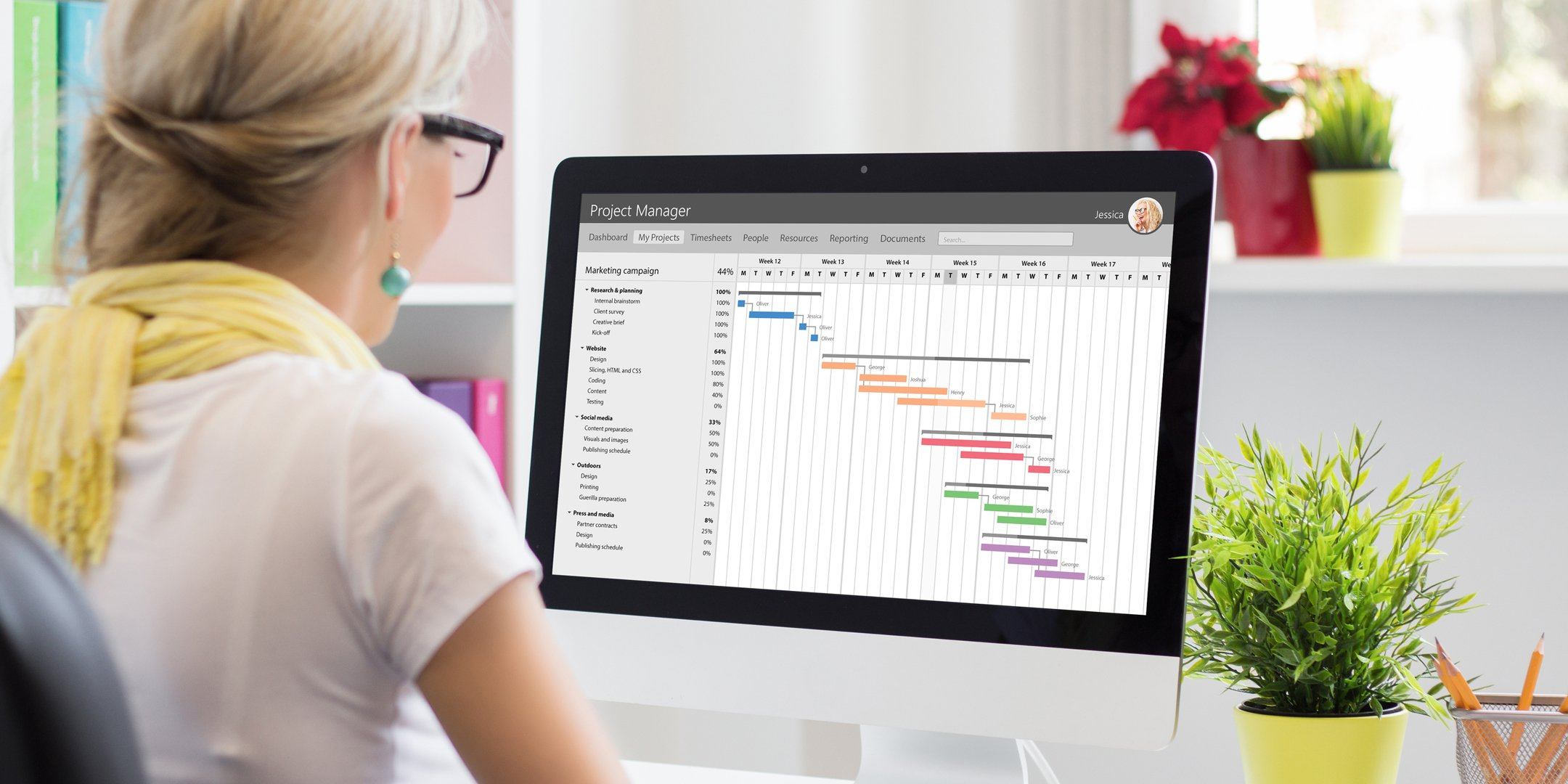 A woman using Enterprise Calendars in Microsoft Project Online.